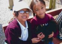 Children holding a chicken at Elkus Ranch