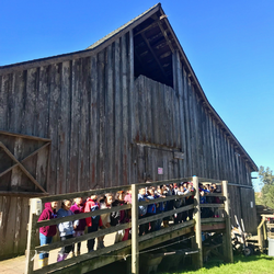 Students pose in front of one of our historic barns