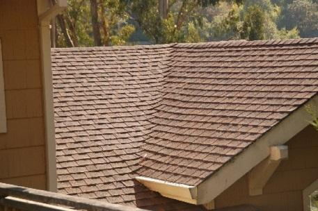Class A asphalt composition shingles in a woven valley