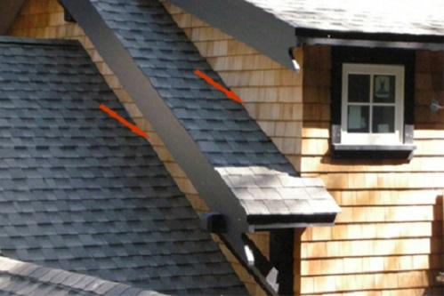 Complex roof design with wood shingle siding