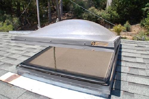 Operable skylight with domed acrylic shell