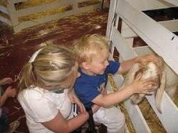 Farm Day - mother, boy, and goat