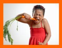 girl eating a carrot