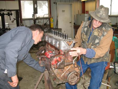 Tony & Al restoring the Farmall.
